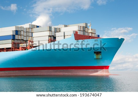 Front part of a large container ship at sea.
