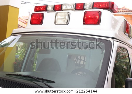 Front part of an ambulance looking for the patient - stock photo