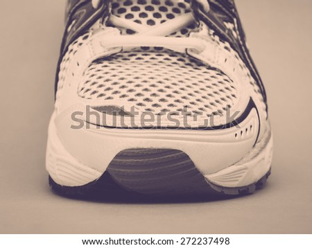 Front part of running shoe, vintage toned - stock photo