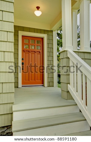 Front porch and door of the green house. - stock photo