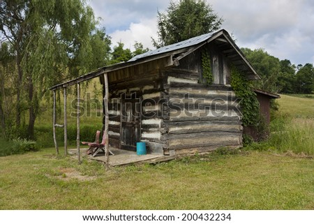 Front porch of rustic cabin in Virginia - stock photo
