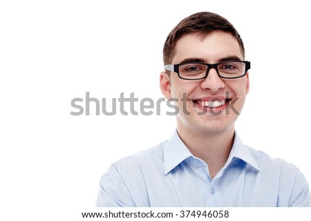Front portrait of young smiling man wearing black glasses and blue formal shirt with open collar isolated on white background - business concept - stock photo
