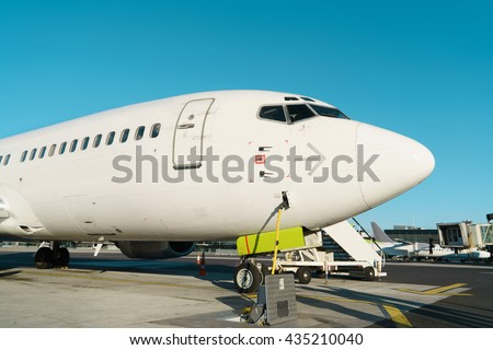 Front profile and cockpit windows of wide-body airplane. - stock photo