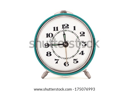 Front shot of old soviet mechanical alarm clock isolated on white background