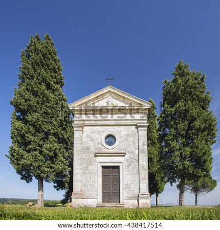 front side of chapel under sky in Tuscany in Italy - stock photo