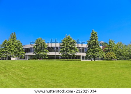 Front side of office building in British Columbia. Cityscape office building with modern architecture. Ecology friendly concept. - stock photo