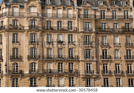 Front side of one of the typical buildings in Paris - stock photo