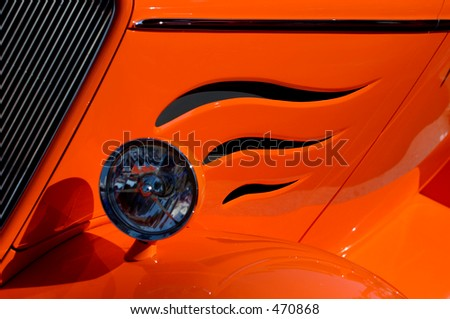 Front side of vintage car with cut flames