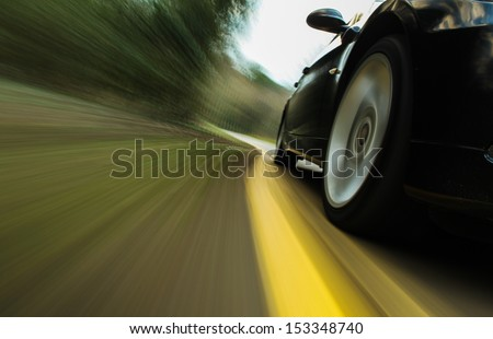 Front side view of speeding car.