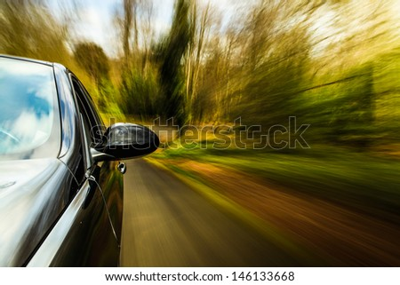Front side view of sport car driving fast. - stock photo