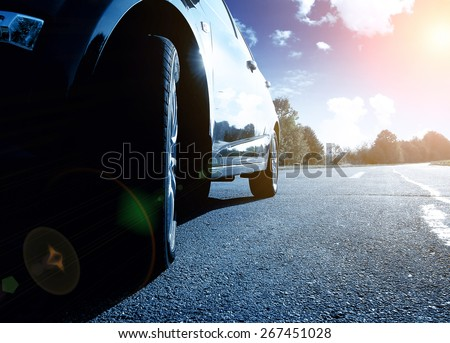 Front side view of the black car driving fast - stock photo