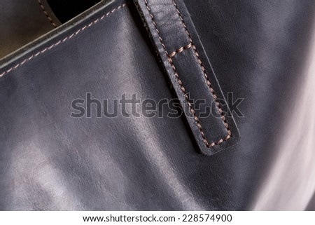 Front surface of brown leather bag closeup - stock photo