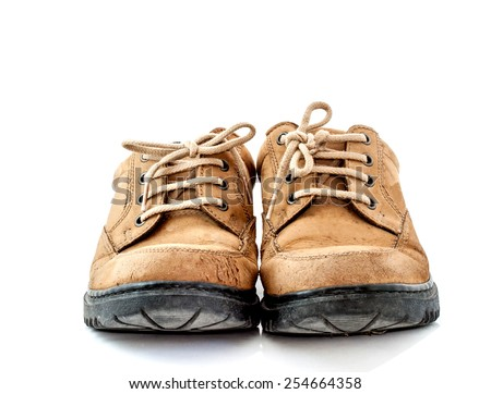 front view image of a pair of old leather brown shoes on white background - stock photo