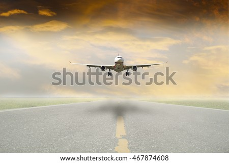 front view of a Airplane trying to land in a fog