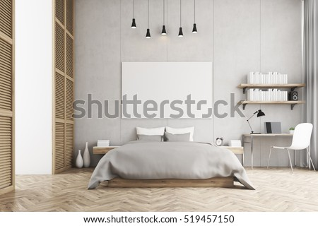 front view of a bedroom with king size bed a bookshelf a table and