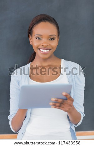 Front view of a black woman standing in a classroom - stock photo