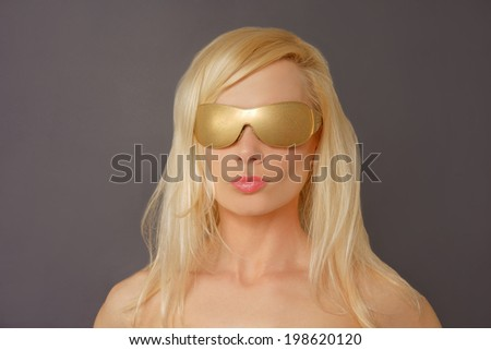 Front view of a Blonde Woman with Gold Glasses. - stock photo