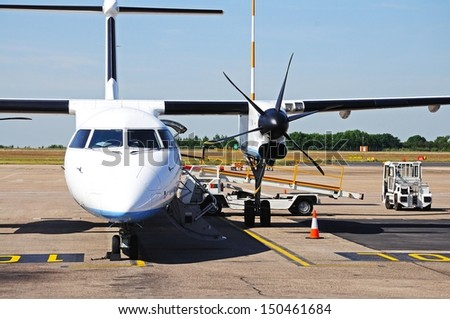 Front view of a Bombardier Dash 8-Q402 parked on the apron, East Midlands Airport, Leicestershire, England, Western Europe. - stock photo