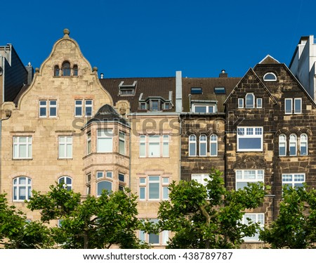 Front view of a couple of old residential houses by the river Rhein promenade in Dusseldorf, Germany.