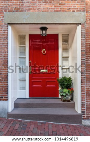 Beau Front View Of A Deep Red Front Door That Is Secured. It Has A Potted
