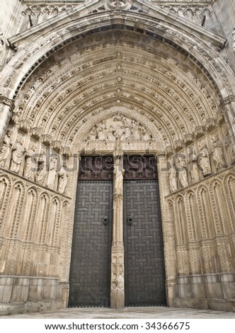 Front view of a door of the gothic Cathedral of Toledo (Spain) - stock photo