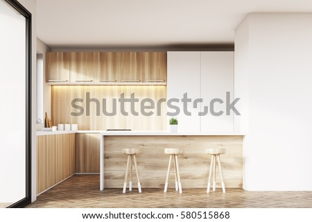 Front View Of A Kitchen Interior With Light Wooden Furniture White Cupboards Counter