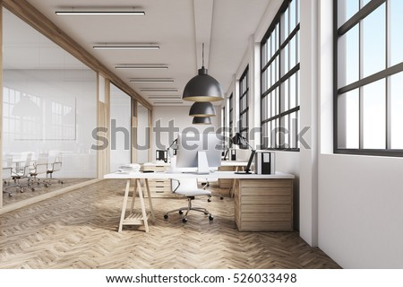 office room. front view of a long office room with wooden floor tables desktops and k