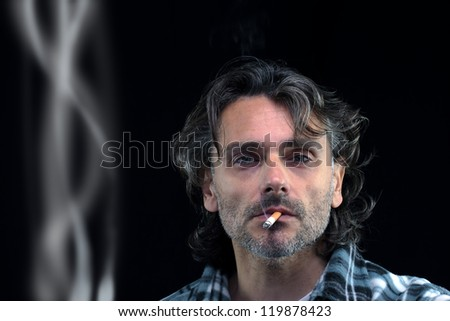 front view of a man smoking over black background