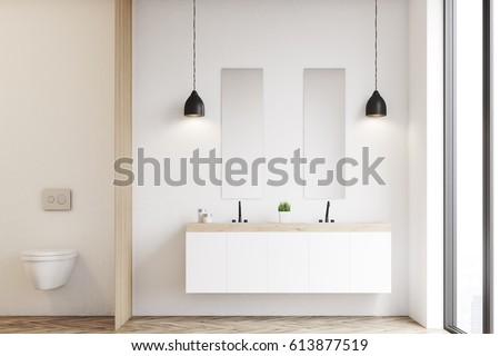Front View Of A Modern Beautiful Bathroom With Toilet And Double Sink The