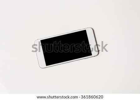 Front view of a modern white mobile smart phone with blank screen on white background - stock photo