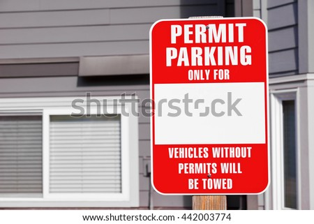 Front view of a parking permit sign in a residential community.