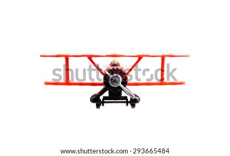 Front view of a plastic toy bi-plane isolated on a white background
