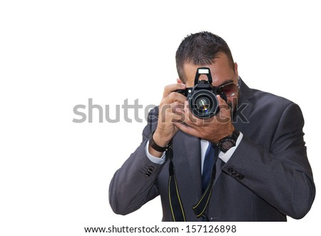 front view of a professional photographer on white background - stock photo