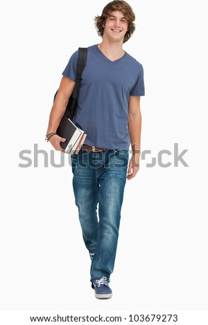 Front view of a student walking with a backpack and books against white background