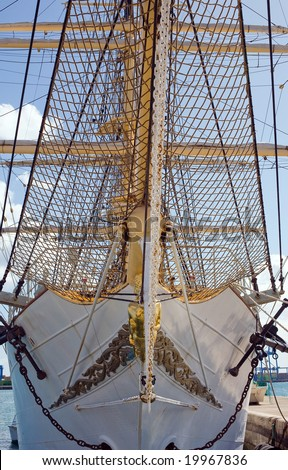 front view of a tall ship under blue sky