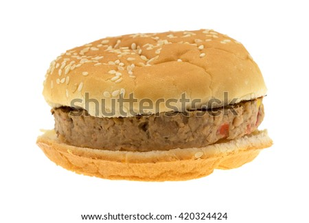 Front view of a veggie burger in a bun isolated on a white background.