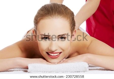 Front view of a woman getting massage in spa. - stock photo