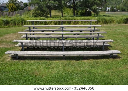Front view of a wooden bleacher - stock photo