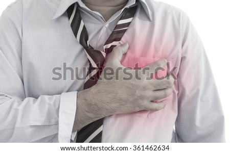 Front view of a young businessman heart  muscle pain (heart disease). Red around the pain area. - stock photo