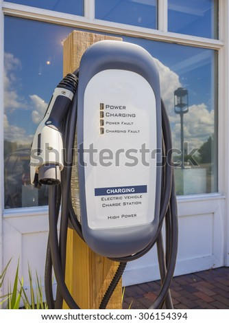 Front view of an electric car charging station. - stock photo