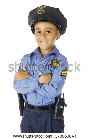 "Front view of an elementary ""policeman"" smiling at the viewer with his arms folded.  On a white background."