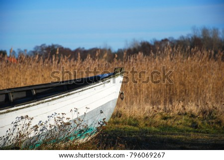 Front view of an old white landed rowing boat