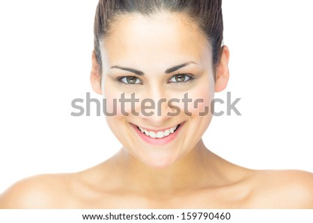 Front view of beautiful brunette woman smiling at camera on white background - stock photo