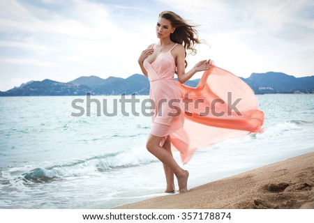 Front view of beautiful unusual woman posing in sea scenery - stock photo