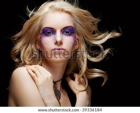 Front view of beauty and sexy woman with creative makeup