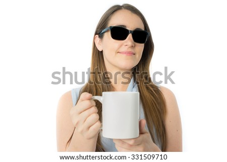 Front view of blind caucasian woman offering cup of coffee, focus in woman face, white cup of coffee for texts - stock photo