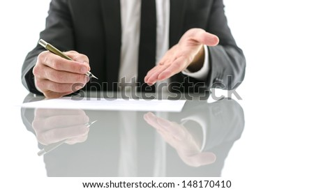 Front view of businessman kindly inviting you to sign a contract. - stock photo