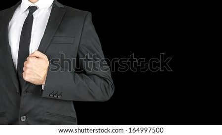 Front view of businessman torso in elegant business suit. Isolated over black background. Empty space ready for your text.