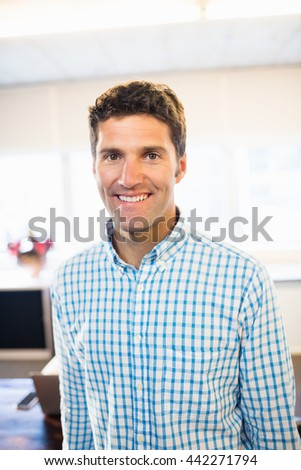 Front view of casual man standing in the office