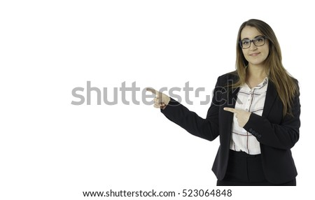 Front view of caucasian woman with suit and glasses looking to left side and pointing with arms